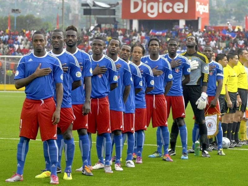 Haiti's national soccer players stand during the playing of their national anthem in Port-au-Prince, ahead of a Concacaf second round qualifier against the US Virgin Islands for the 2014 World Cup finals in Brazil.