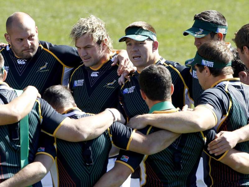 South African captain John Smit (C) talks to his team at a training session in Wellington ahead of the 2011 Rugby World Cup.
