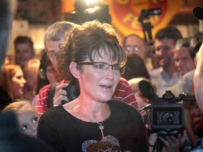 Former Alaska Governor Sarah Palin greets supporters at an event sponsored by Conservatives4Palin in Urbandale, Iowa.