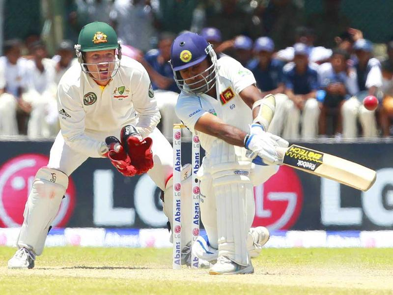 Sri Lanka's Mahela Jayawardene plays a shot next to Australia's Brad Haddin during the fourth day of their first Test cricket match in Galle.