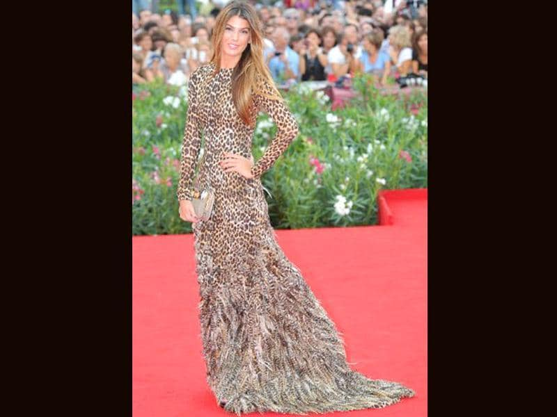 Italian supermodel Bianca Brandolini is the foxy fashionista in a leopard print, feather trail dress.