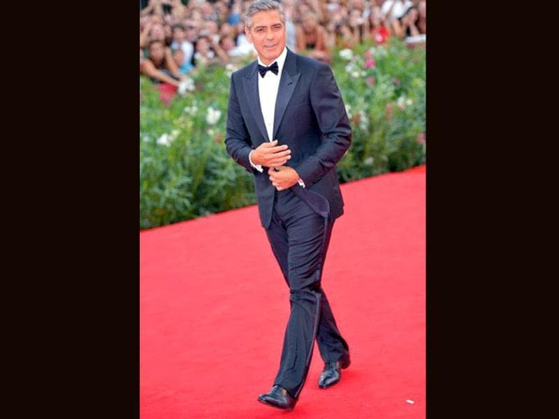 There's something about men in suits. George Clooney looks his usual dapper self in tuxedo.