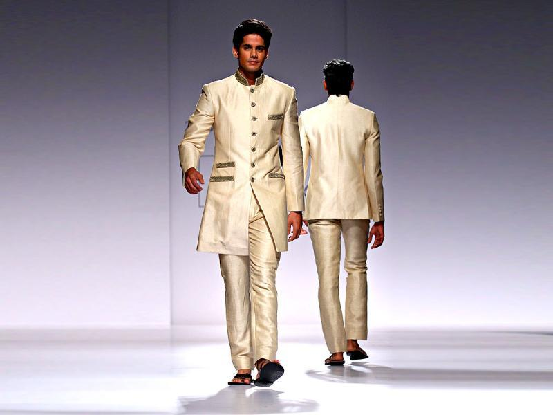 The off-white silk suit is a beautiful blend in Zubair Kirmani's Western and Indian formal wear.