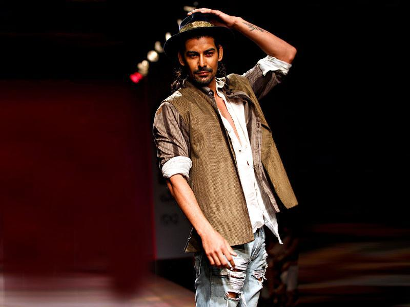 Ripped jeans and the hat make for an easy casual look by Krishna Mehta.