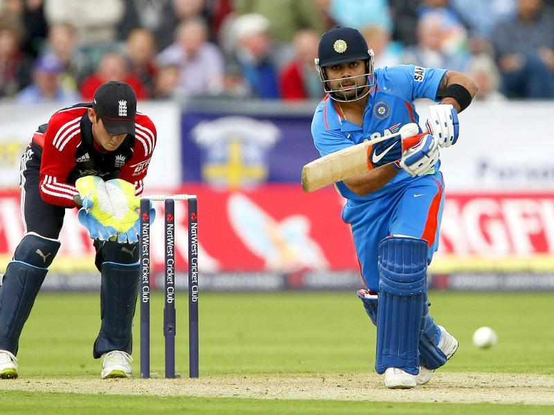 Virat Kohli, right, plays a shot as England wicketkeeper Craig Kieswetter looks on during the first one day international cricket match at the Riverside Cricket Ground in Durham, England.