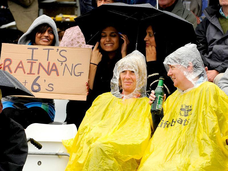 Spectators wait in the stand after rain interrupted play during the first one-day international cricket match between England and India at the Riverside cricket ground in Chester le Street, England.