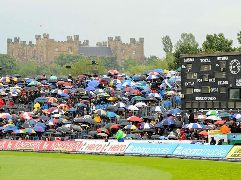 Spectators wait as rain delayed play with Lumley castle in the background during the first ODI cricket match between England and India at the Riverside cricket ground in Chester le Street.