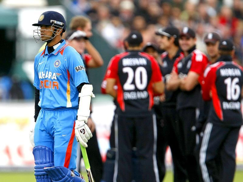 Rahul Dravid leaves the field after losing his wicket to England's Stuart Broad, not pictured, during the first one day international cricket match at the Riverside Cricket Ground in Durham, England.