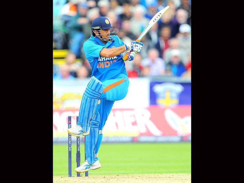 India's Mahendra Singh Dhoni plays a shot during the One Day International (ODI) cricket match between England and India at the Riverside cricket ground in Durham, north-east England.