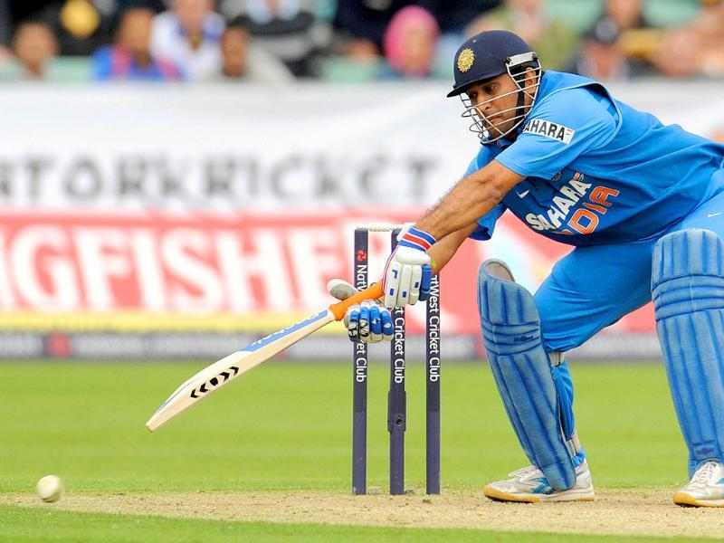 Mahendra Singh Dhoni attempts to reach a ball during the first ODI cricket match against England at the Riverside cricket ground in Chester le Street, England.