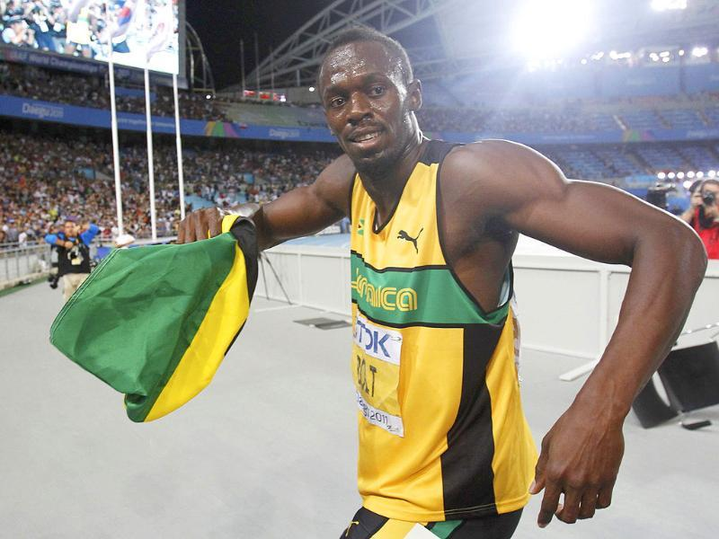 Usain Bolt of Jamaica celebrates winning the men's 200 metres final at the IAAF World Athletics Championships in Daegu.