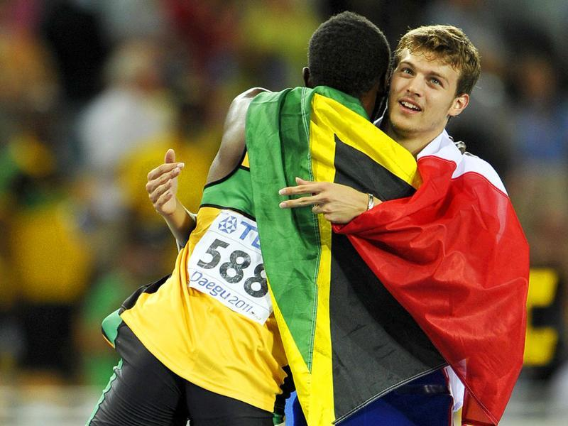 Usain Bolt of Jamaica and Christophe Lemaitre of France celebrate after the men's 200 metres final at the IAAF World Athletics Championships in Daegu.