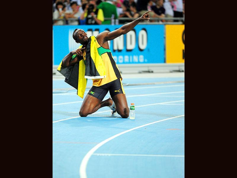 Jamaica's Usain Bolt strikes his trademark lightning pose after winning gold in the men's 200 metres final at the International Association of Athletics Federations (IAAF) World Championships in Daegu.