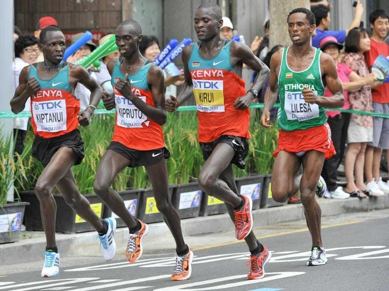 Abel Kirui of Kenya (2R) leads the field from Feyisa Lilesa of Ethiopia (R), Eliud Kiptanui of Kenya (L) and Vincent Kipruto of Kenya (2L) during the men's marathon at the International Association of Athletics Federations (IAAF) World Championships in Daegu. Abel Kirui of Kenya won in 2:07:38 to take the gold medal.