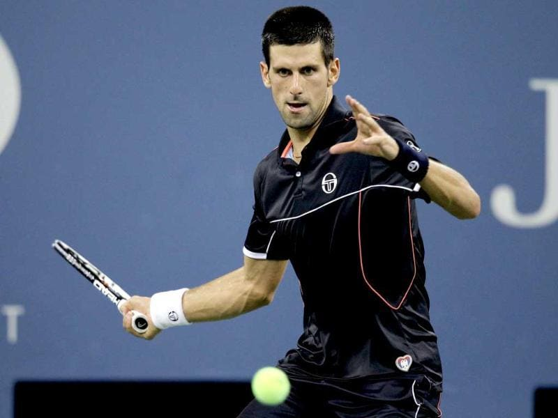 Novak Djokovic of Serbia returns a shot to Nikolay Davydenko of Russia during Day Six of the 2011 US Open at the USTA Billie Jean King National Tennis Center in the Flushing neighborhood of the Queens borough of New York City.