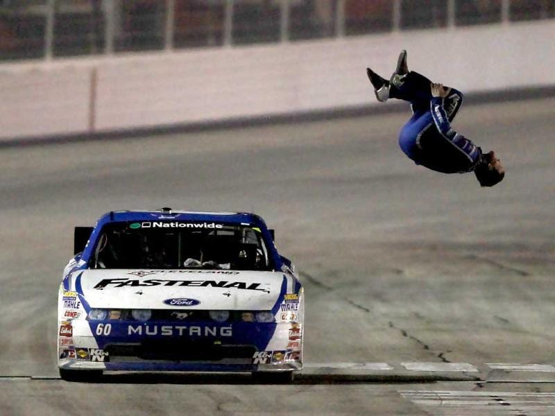 Carl Edwards, driver of the #60 Fastenal Ford, celebrates with a backflip after winning the NASCAR Nationwide Series Great Clips 300 at Atlanta Motor Speedway on September 3, 2011 in Hampton, Georgia.
