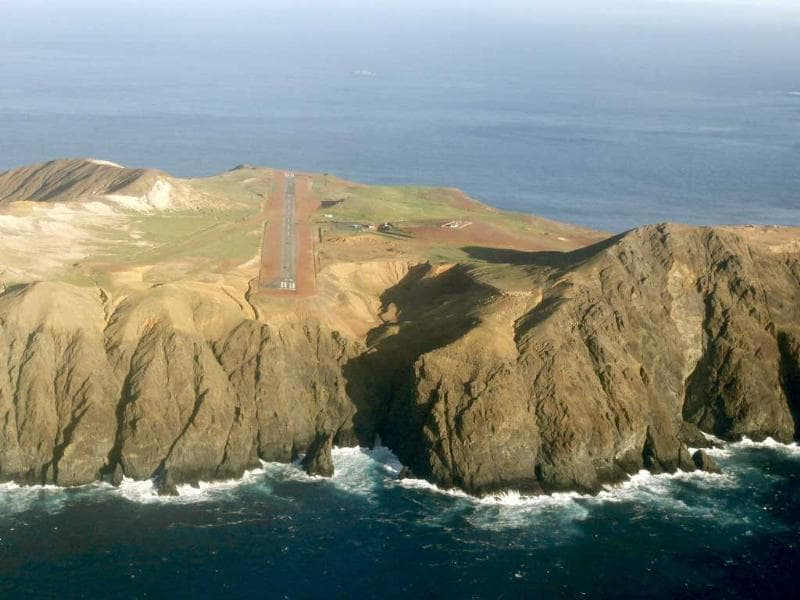 An aerial view from a Chilean air force plane shows Juan Fernandez islands' landing strip, about 420 miles (676 km) off Chile's coast. All 21 people aboard a military aircraft that crashed into the Pacific Ocean off the remote Juan Fernandez islands perished.