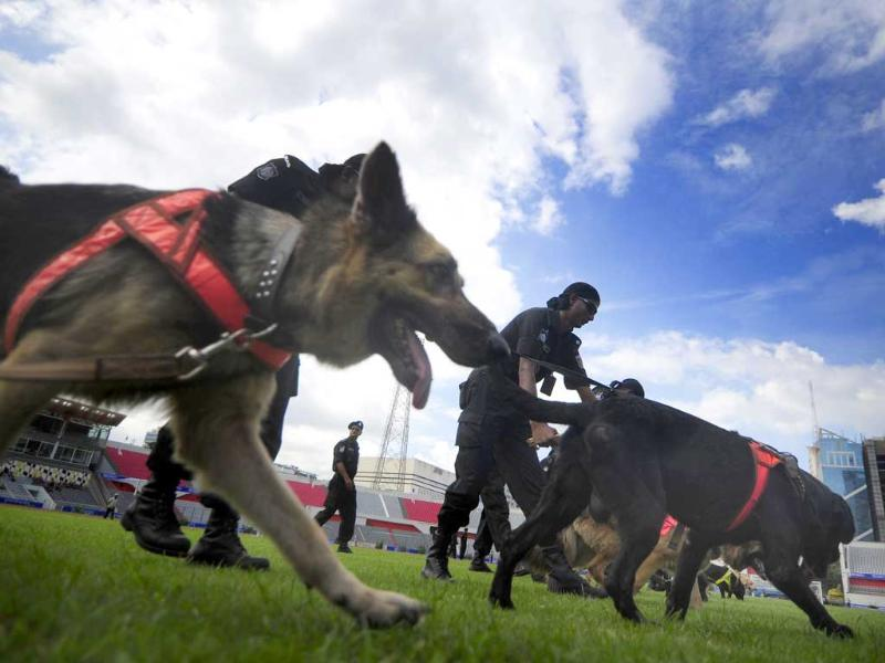 Members of the Bangladeshi Rapid Action Battalion (RAB) run through a security drill with sniffer dogs in the Bangabandhu National Stadium in Dhaka.
