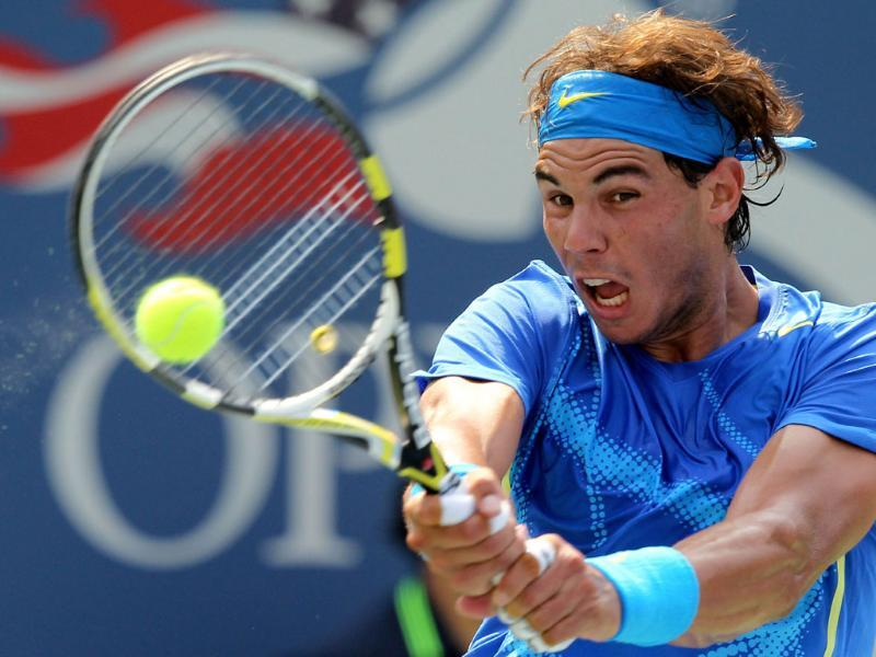 Rafael Nadal of Spain returns a shot against David Nalbandian of Argentina during Day Seven of the 2011 US Open at the USTA Billie Jean King National Tennis Center of New York City.
