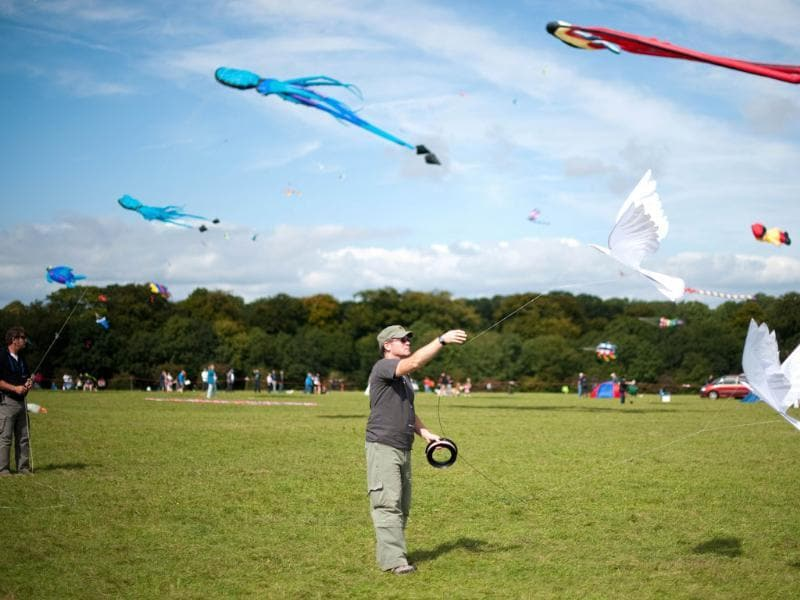A man flies a kite made up of two doves at the 25th annual Bristol International Kite Festival on the Ashton Court Estate near Bristol.