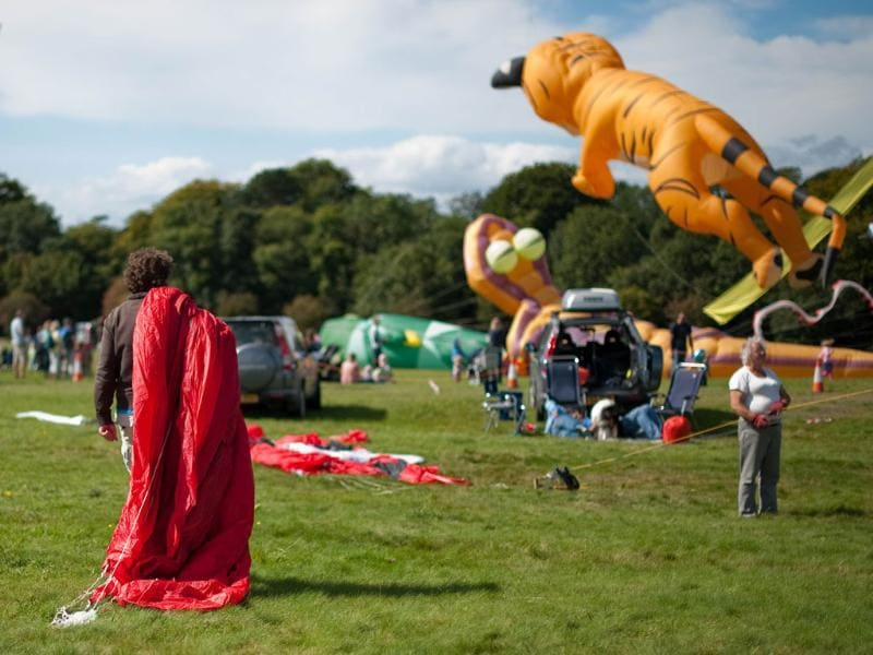 A man carries his kite away from the flying arena at the 25th annual Bristol International Kite Festival on the Ashton Court Estate near Bristol.