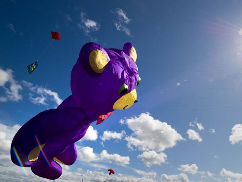 A giant teddy bear kite flies at the 25th annual Bristol International Kite Festival on the Ashton Court Estate near Bristol.