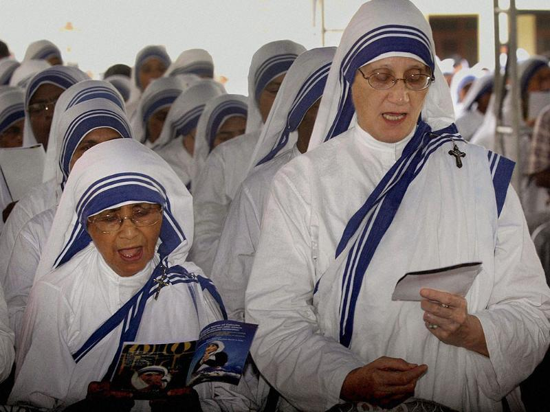 Superior general of the Missionaries of Charity Sister Prema (R) and former superior general Sister Nirmala during the Birth Centenary Eucharistic celebration of Blessed Mother Teresa at St. Xaviers College, in Kolkata.