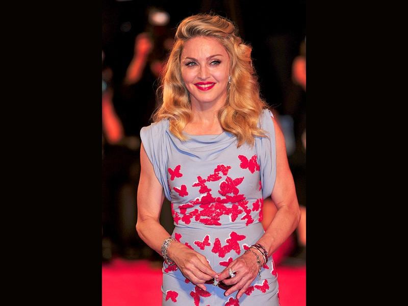 Madonna matches her lipstick to the red butterflies on her dress.