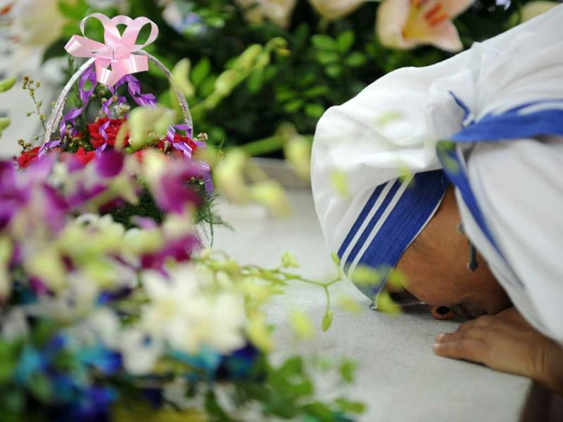 A nun from the order of the Missionaries of Charity pays tribute to Mother Teresa, in front of her tomb, at Mother House in Kolkata.