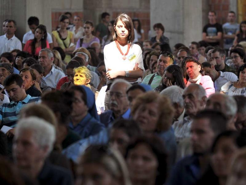 A catholic woman attends a congregation to mark the anniversary of Mother Teresa's death in Pristina, Kosovo.