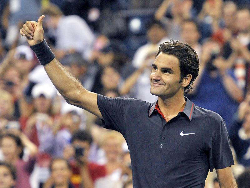 Roger Federer of Switzerland thanks the crowd after defeating Juan Monaco of Argentina following their match at the US Open tennis tournament in New York.