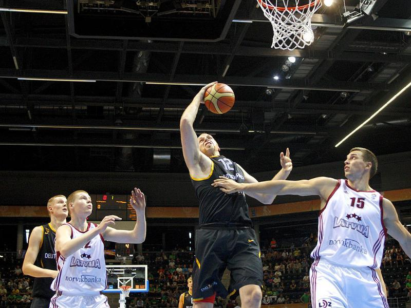 Andrejs Selakovs (R) from Latvia fights for a rebound with Chris Kaman (L) from Germany during the EuroBasket European Basketball Championship Group B match in Siauliai, Lithuania.