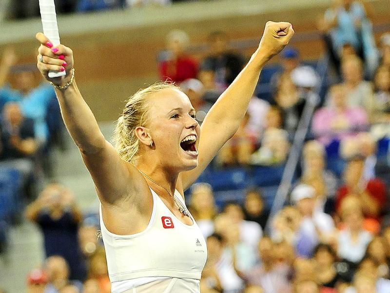 Danish tennis player Caroline Wozniacki celebrates after winning against Russia's Svetlana Kuznetsova during their Women's US Open 2011 fourth round match at the USTA Billie Jean King National Tennis Center in New York.