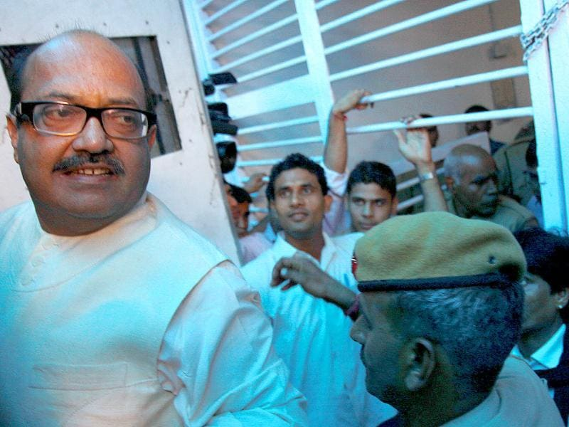 Rajya Sabha MP Amar Singh, who was arrested for his alleged role in the cash-for-votes scandal being taken to Tihar Jail from Tis Hazari court in New Delhi.