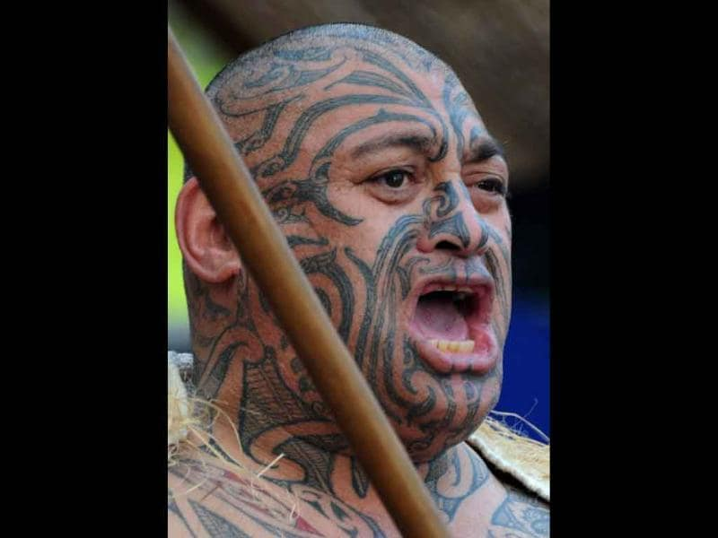 A performer reacts during a full Powhiri, a traditional Maori ceremony for welcoming visitors, as they await the arrival of the Wallabies rugby union team in Auckland.