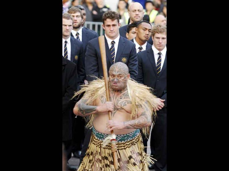 Australia captain James Horwill (C) watches a local Ngati Whatua warrior at a welcome ceremony for the Australia Rugby World Cup team in Auckland.