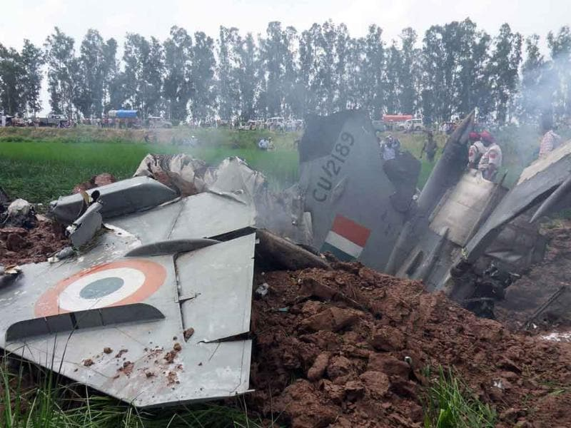Indian Air Force personnel stand by the wreckage of a MiG-21 aircraft that crashed in a field in Rajgarh, in Patiala district.