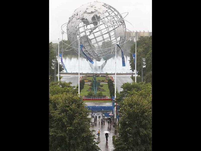 People arrive for the US Open tennis tournament in New York.