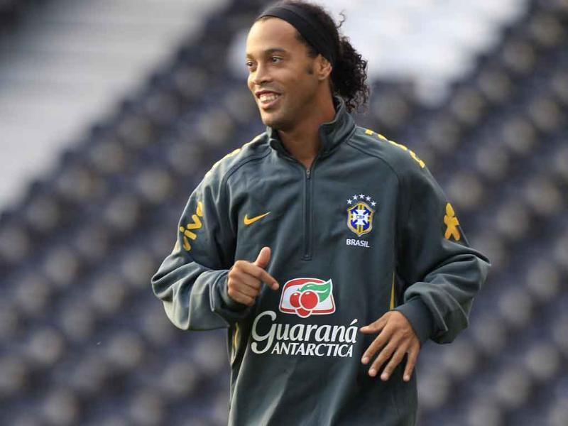 Brazil soccer squad's Ronaldinho jokes during a training session at Fulham's Craven Cottage ground in London.