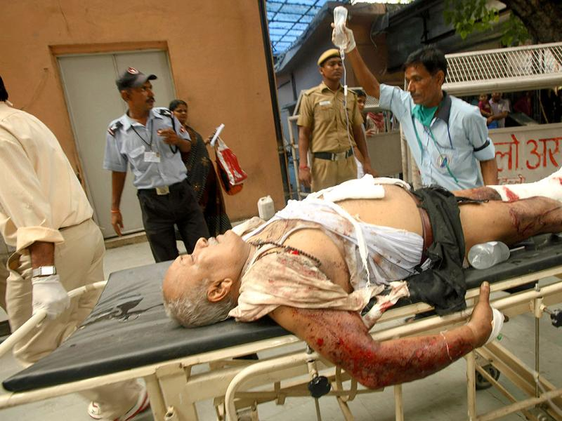A man injured in bomb blast is brought to the RML hospital in New Delhi.
