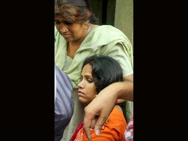 Relatives mourn outside RML Hospital after a powerful bomb blast outside Delhi high court, in New Delhi.