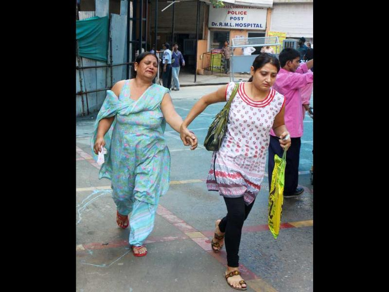 Relatives rushing to the RML Hospital after a powerful bomb blast outside Delhi high court, in New Delhi.