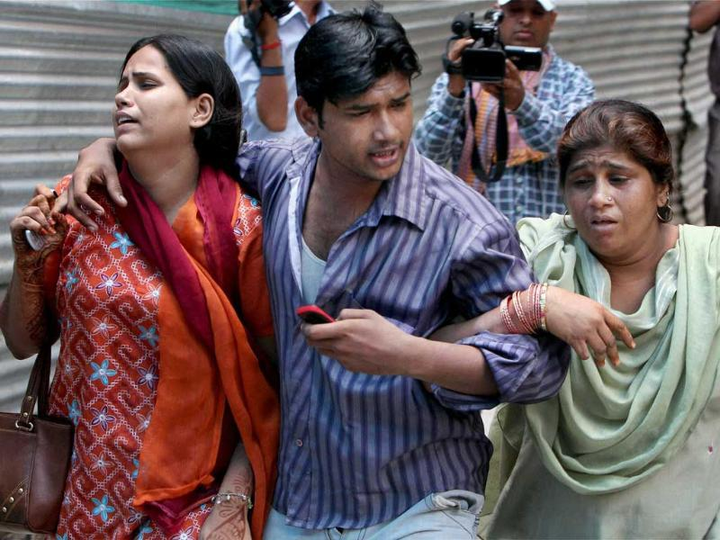 Relatives of victims of the Delhi high court bomb blast at RML Hospital.