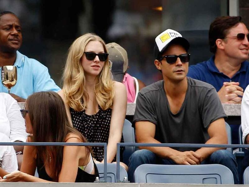 Actress Amanda Seyfried (L) watches Anastasia Pavlyuchenkova of Russia play against Francesca Schiavone of Italy during Day Eight of the 2011 US Open at the USTA Billie Jean King National Tennis Center.
