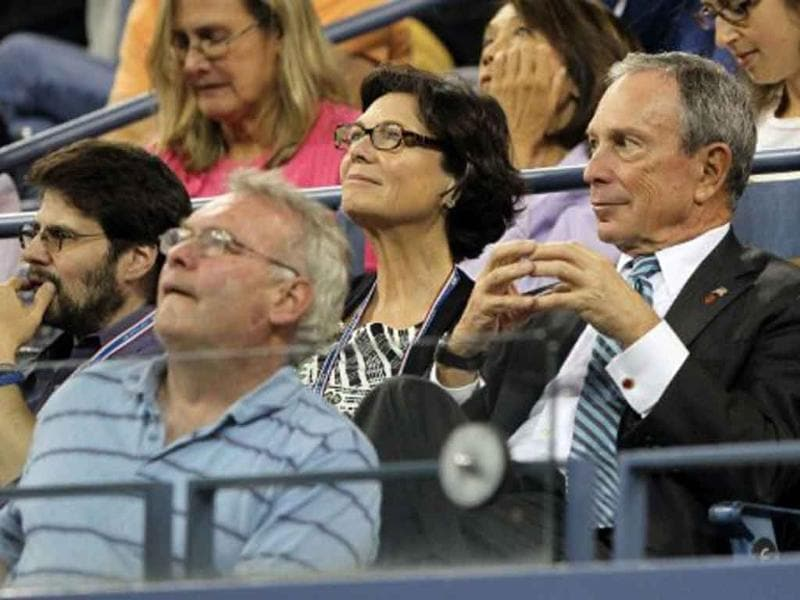 New York City mayor Michael Bloomberg watches Roger Federer of Switzerland play against Santiago Giraldo of Colombia during a 2011 US Open match.