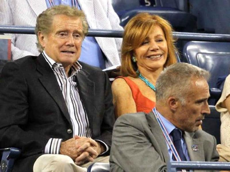 Regis Philbin and his wife Joy watch as Andy Roddick of the United States plays against Michael Russell of the United States during Day Three of the 2011 US Open.