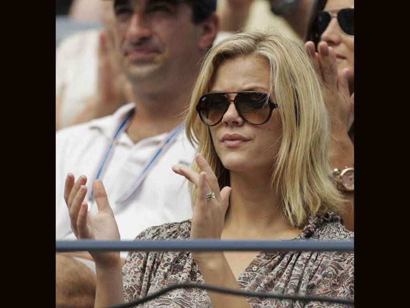 Actress Brooklyn Decker watches Andy Roddick play Julien Benneteau of France during the US Open tennis tournament in New York.