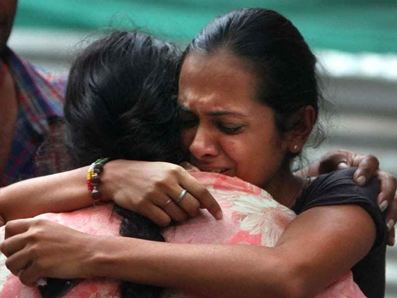 Relatives of a high court blast victim mourn at the RML hospital in New Delhi.