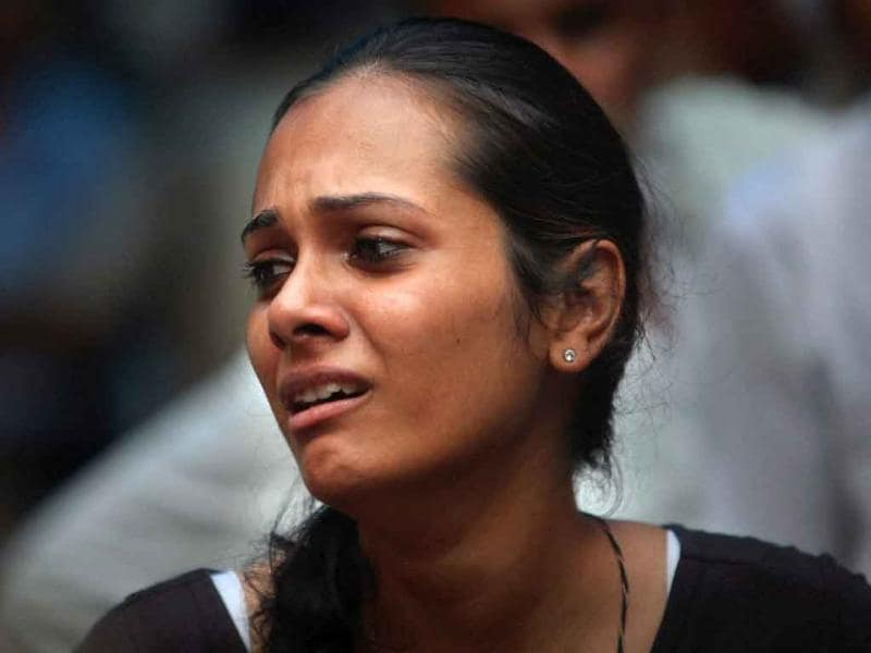 A relative of a high court blast victim wails at the RML hospital in New Delhi.