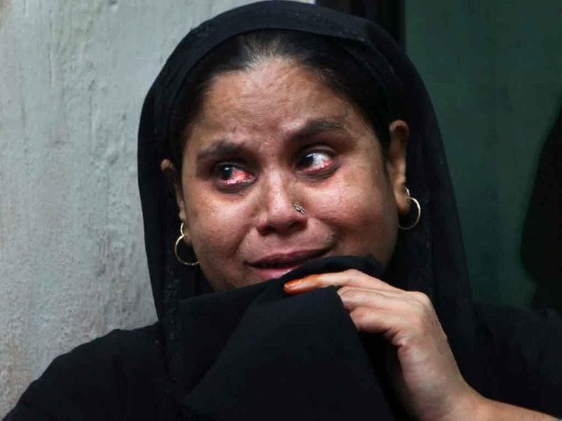 Mumtaz whose father Nizamuddin was killed in a bomb explosion at the high court, waits for the release of his body at the RML hospital in New Delhi.